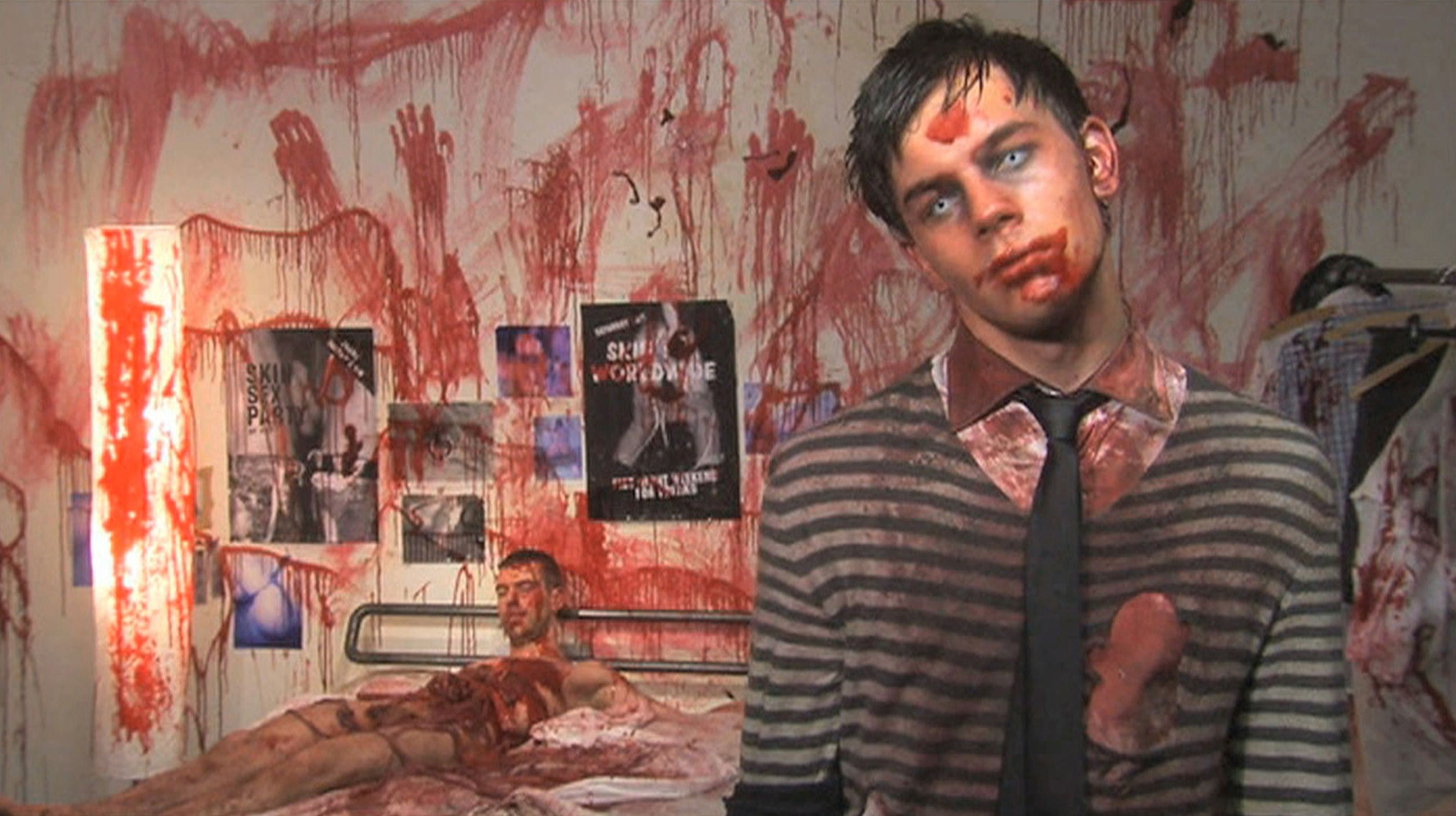 Otto the zombie (Jey Crisfar) with the corpse of one of his liaisons in Otto; or, Up With Dead People (2008)