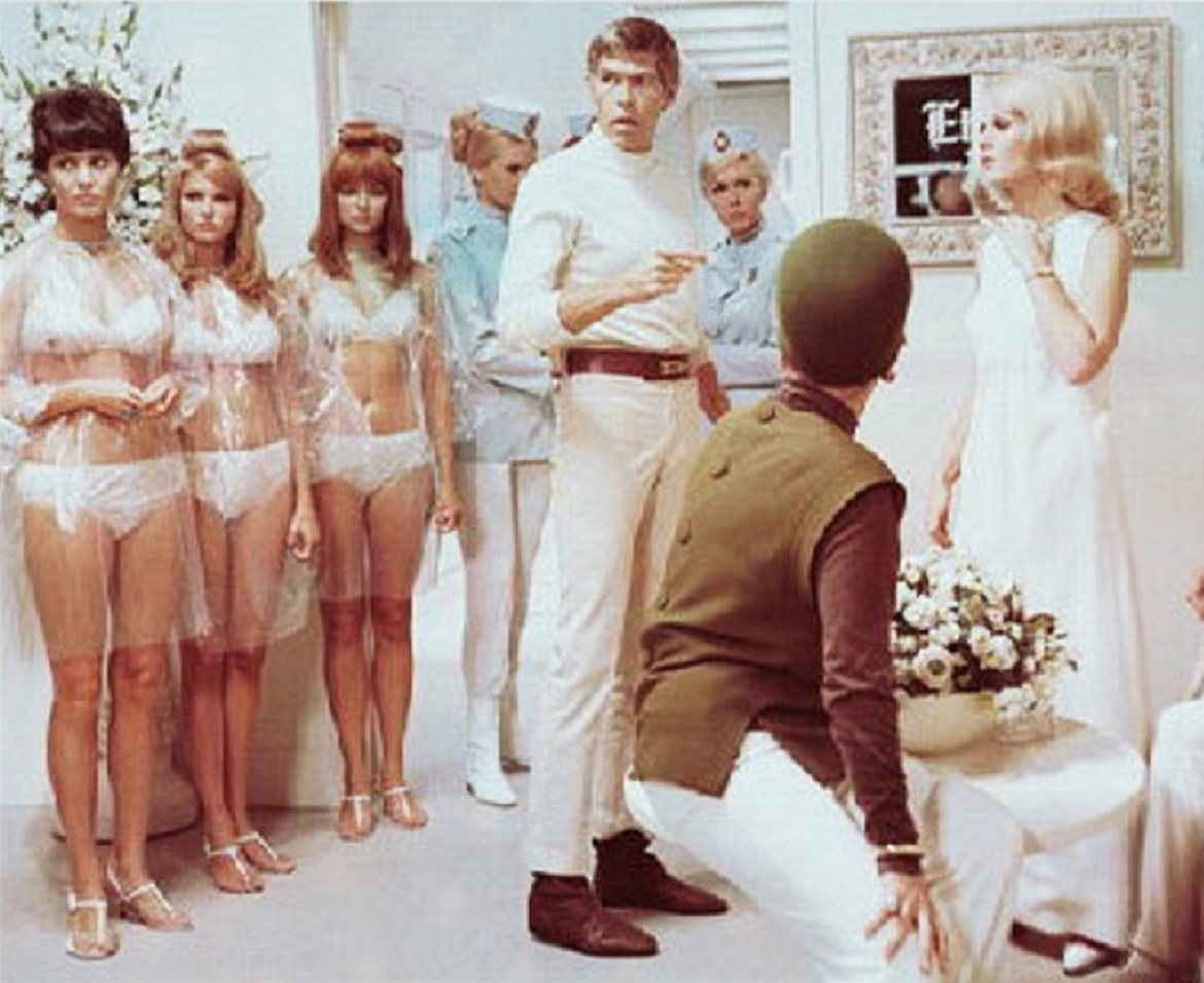 Derek Flint (James Coburn) and a bevy of women in Our Man Flint (1966)
