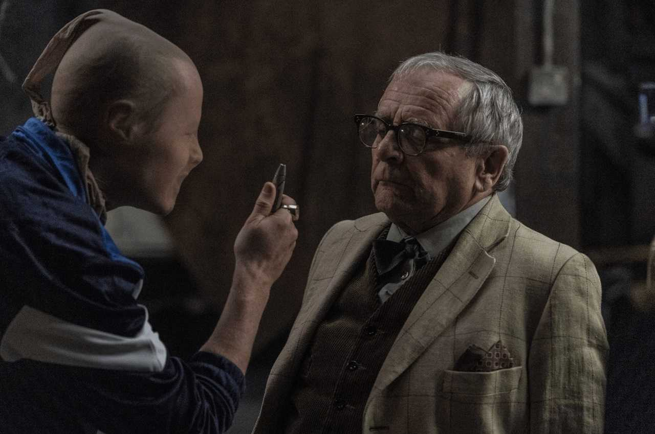 Jake Curran threatens Sylvester McCoy in The Owners (2020)