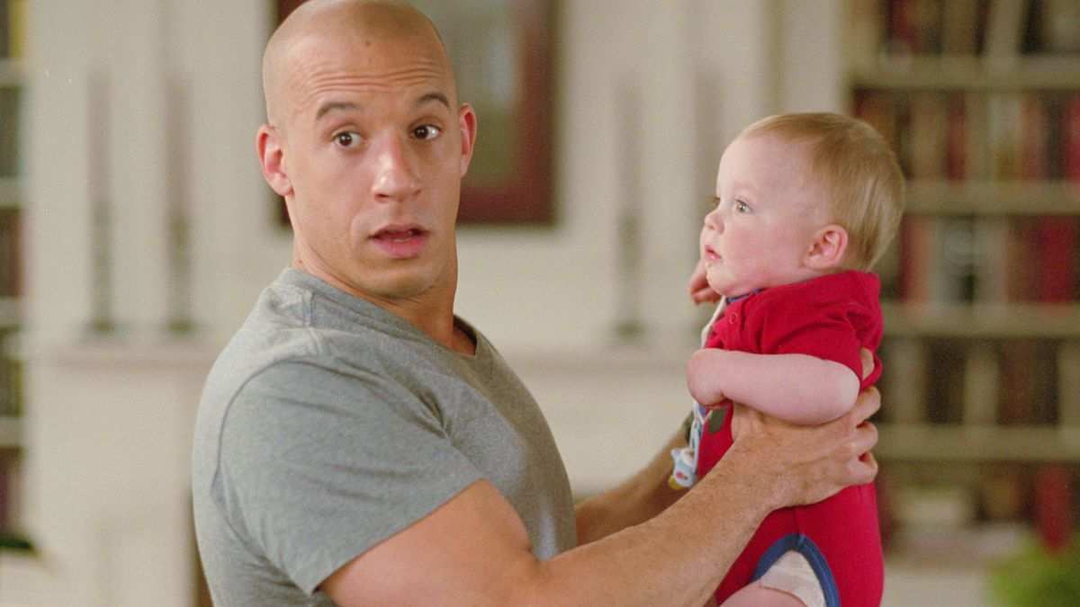 Vin Diesel with baby in The Pacifier (2005)