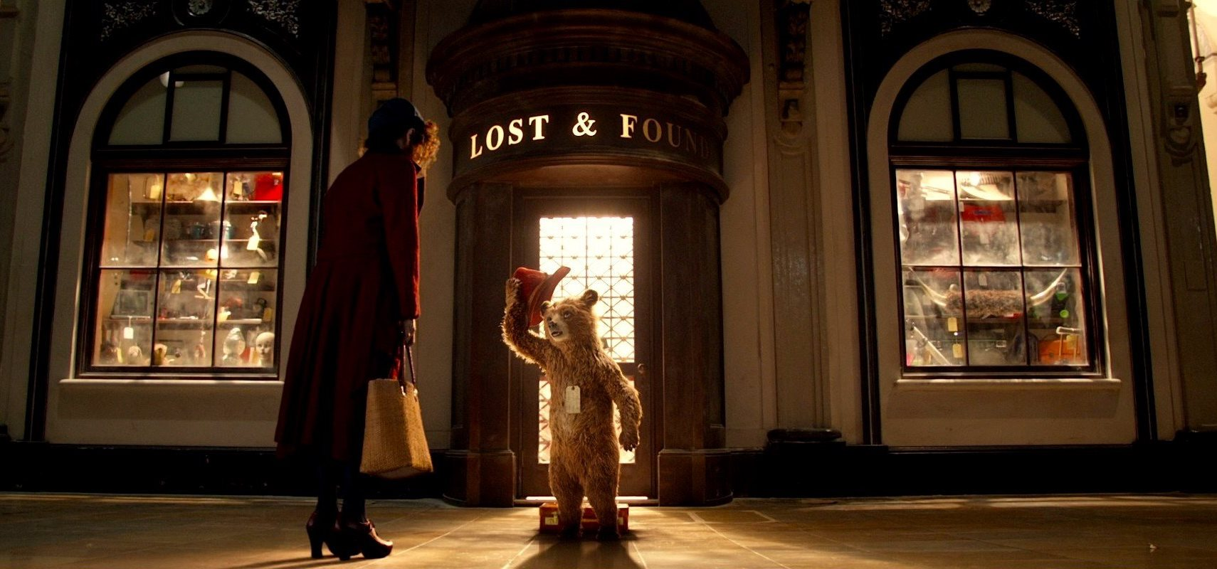 Sally Hawkins encounters Paddington outside the Lost and Found at Paddington Station in Paddington (2014)