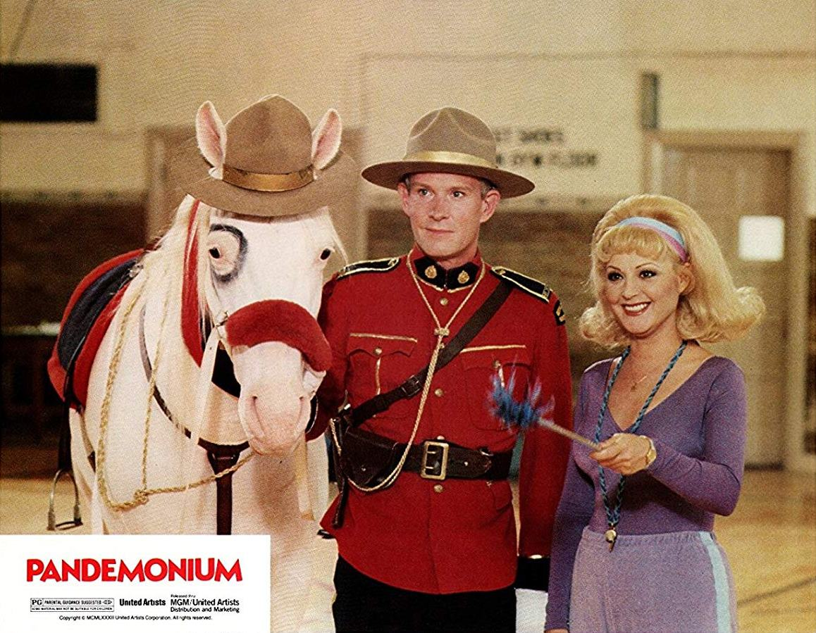 Tom Smothers as the Canadian Mountie who has unnatural affections for his horse and Candy Azzara as the head of the cheerleading school in Pandemonium/Thursday the 12th (1982)