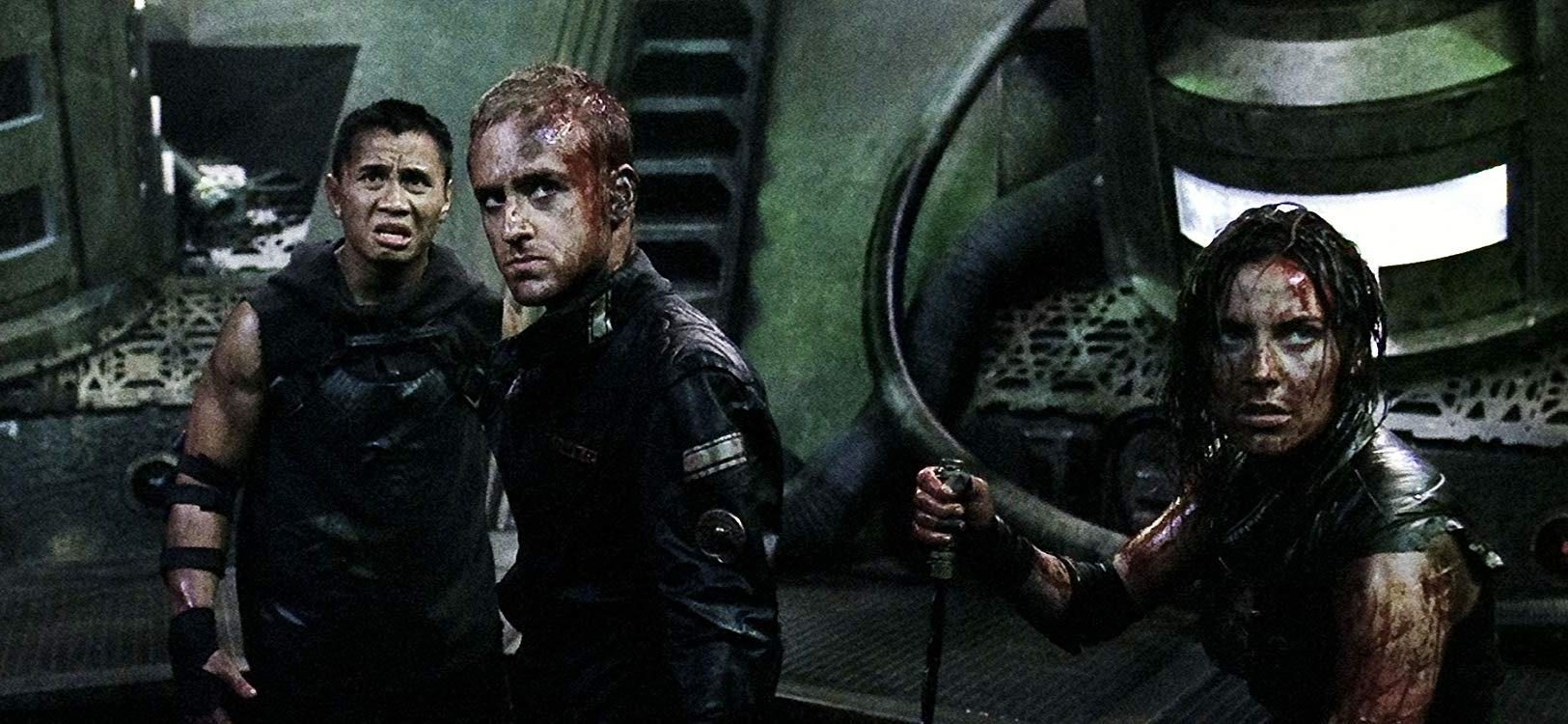Survivors aboard The Elysium - (l to r) Cung Le, Ben Foster and Antje Traue in Pandorum (2009)