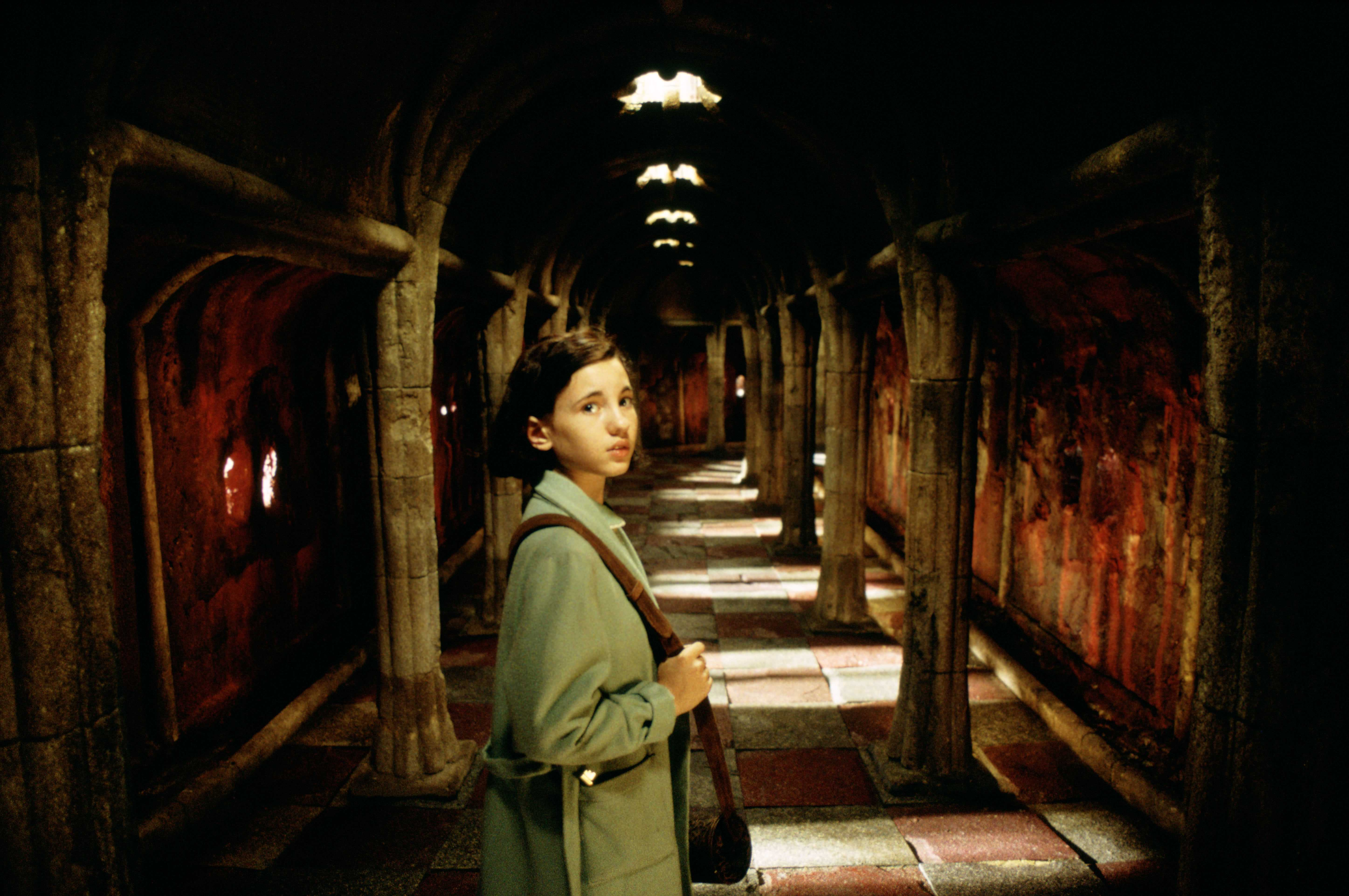Ofelia (Ivana Baquero) makes her way into the labyrinth in Pan's Labyrinth (2006)