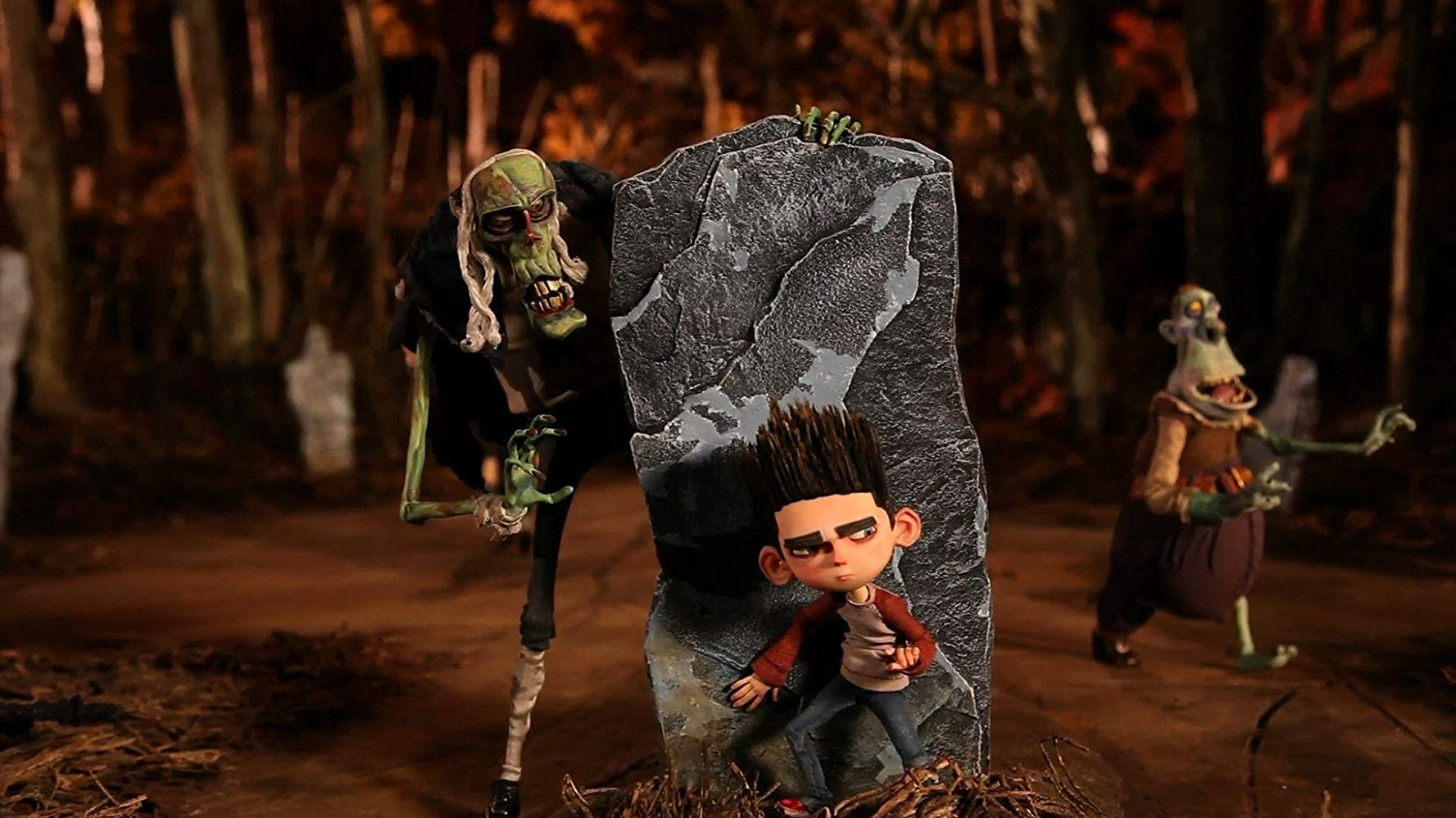Norman (voiced by Kodi Smit-McPhee) (c) menaced by the Judge (voiced by Bernard Hill) (l) and other zombies in ParaNorman (2012)