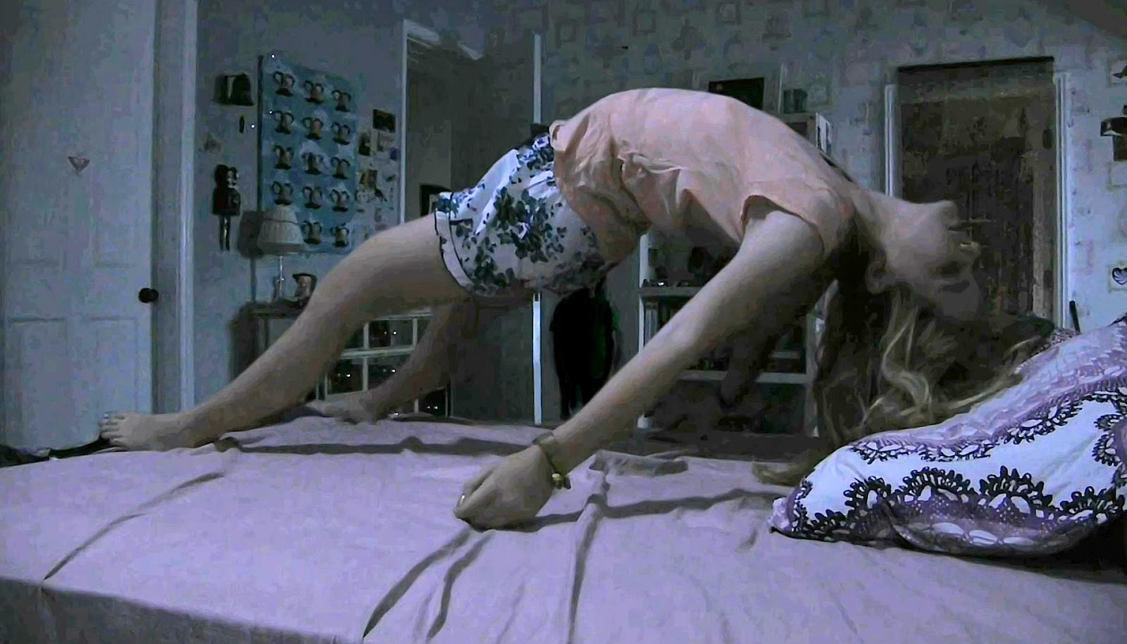 A levitated Kathryn Newton in Paranormal Activity 4 (2012)