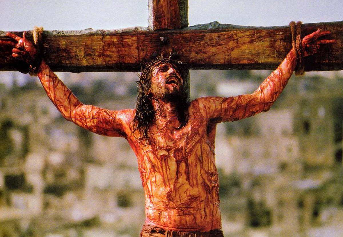 The crucifixion of Jesus (Jim Caviezel) in The Passion of the Christ (2004)