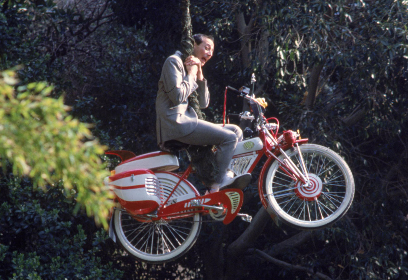 Pee-Wee Herman (Paul Reubens) swings into action on his beloved bicycle in Pee-Wee's Big Adventure (1985)