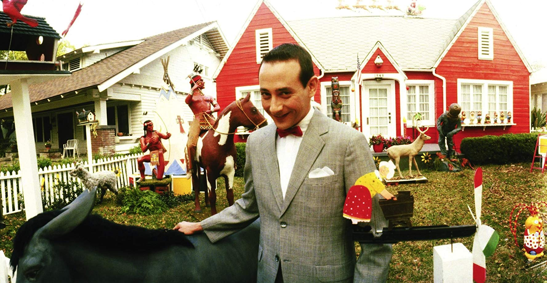 Pee-Wee Herman (Paul Reubens) in front of his kitsch house in Pee-Wee's Big Adventure (1985)