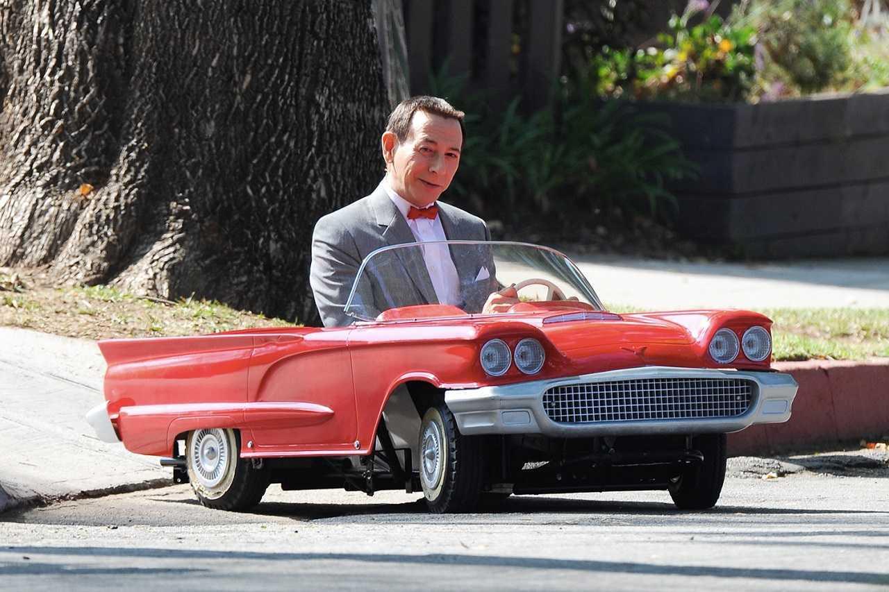 Pee-Wee Herman (Paul Reubens) and miniature car in Pee-Wee's Big Holiday (2016)