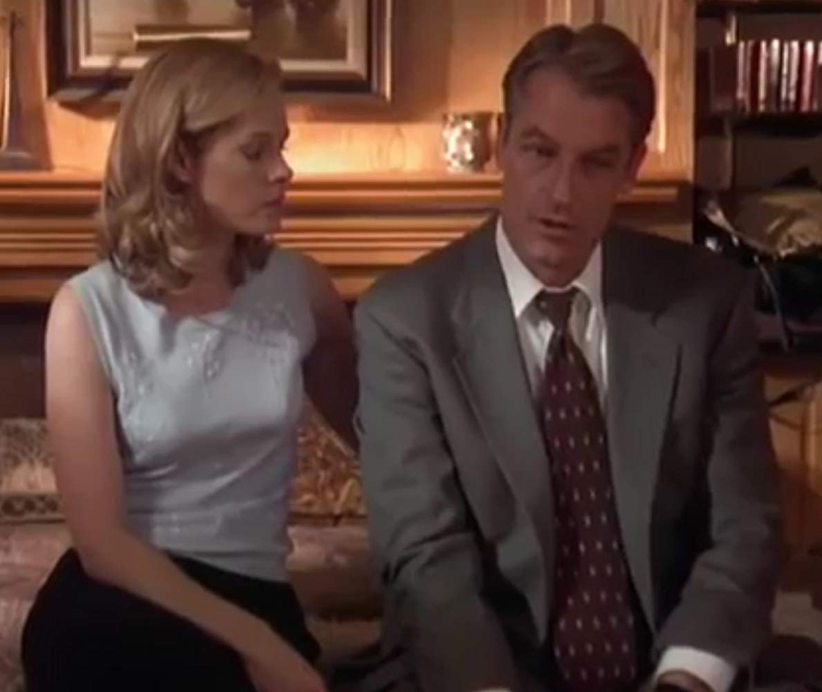 Shannon Sturges as the revenge-seeking wife with husband Perry King in The Perfect Wife (2001)