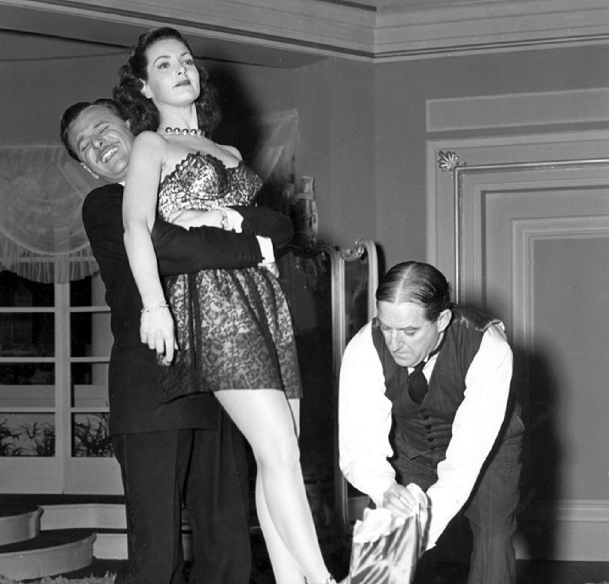 Nigel Patrick and Sterling Holloway wrestle android woman Patricia Roc into place in The Perfect Woman (1949)