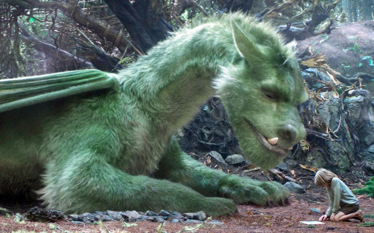 Pete (Oakes Fegley) and Elliott the dragon in Pete's Dragon (2016)