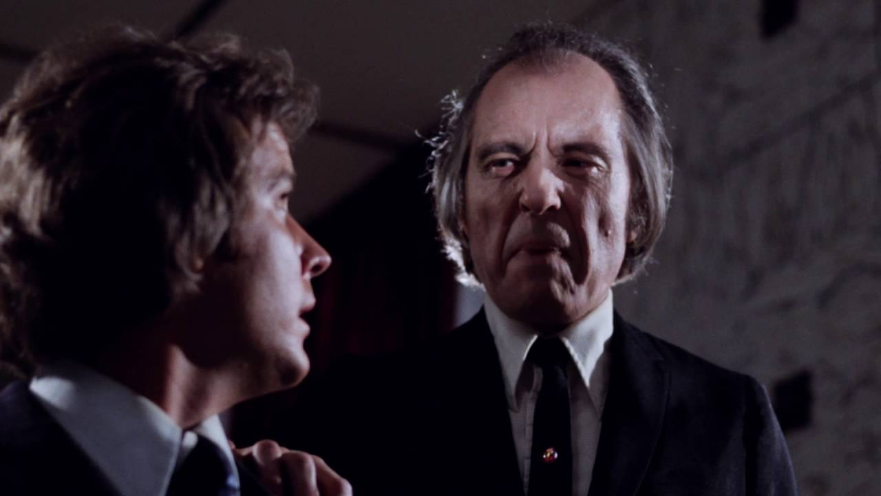 Tommy (Bill Cone) menaced by The Tall Man (Angus Scrimm) in Phantasm (1979)