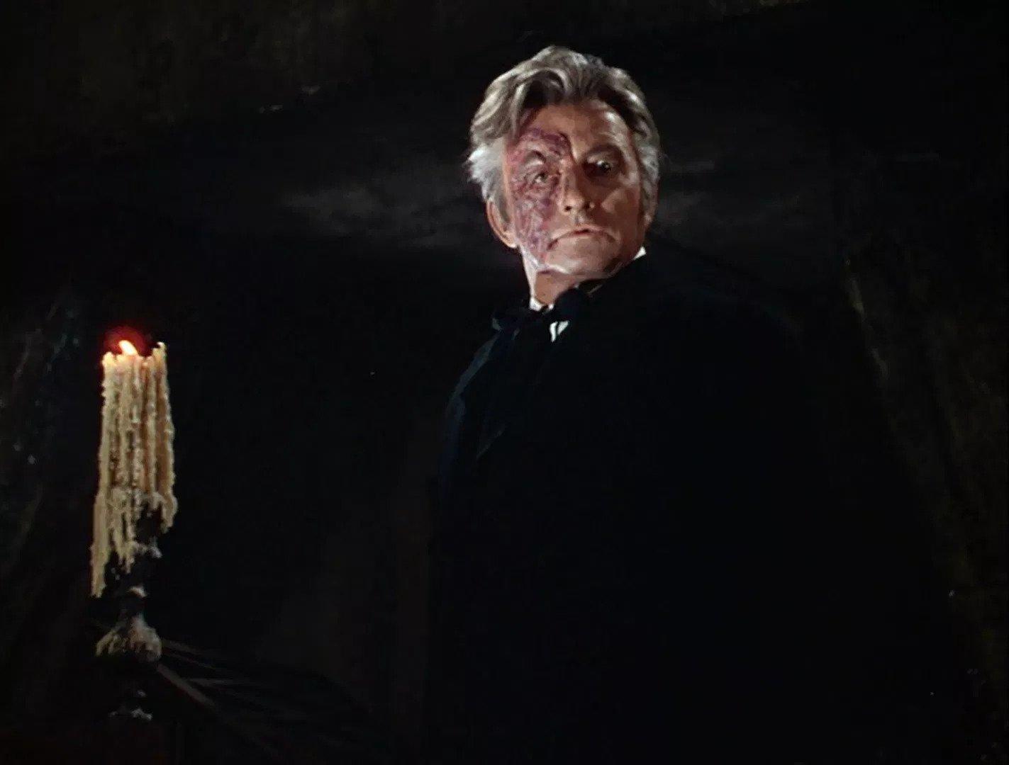 Claude Rains as The Phantom, Enrique Claudin in Phantom of the Opera (1943)