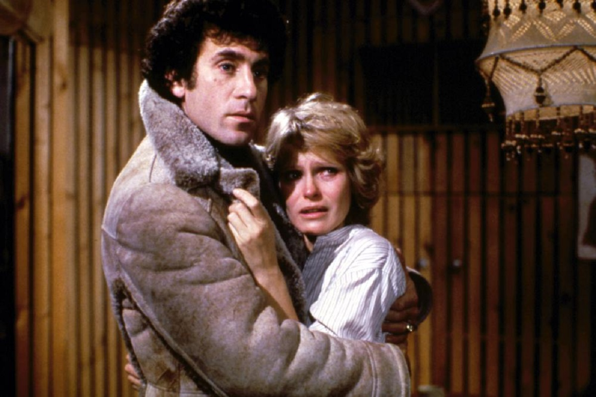 Psychiatrist Paul Michael Glaser comforts Susan Hogan as a killer eliminates the patients in his group in Phobia (1980)