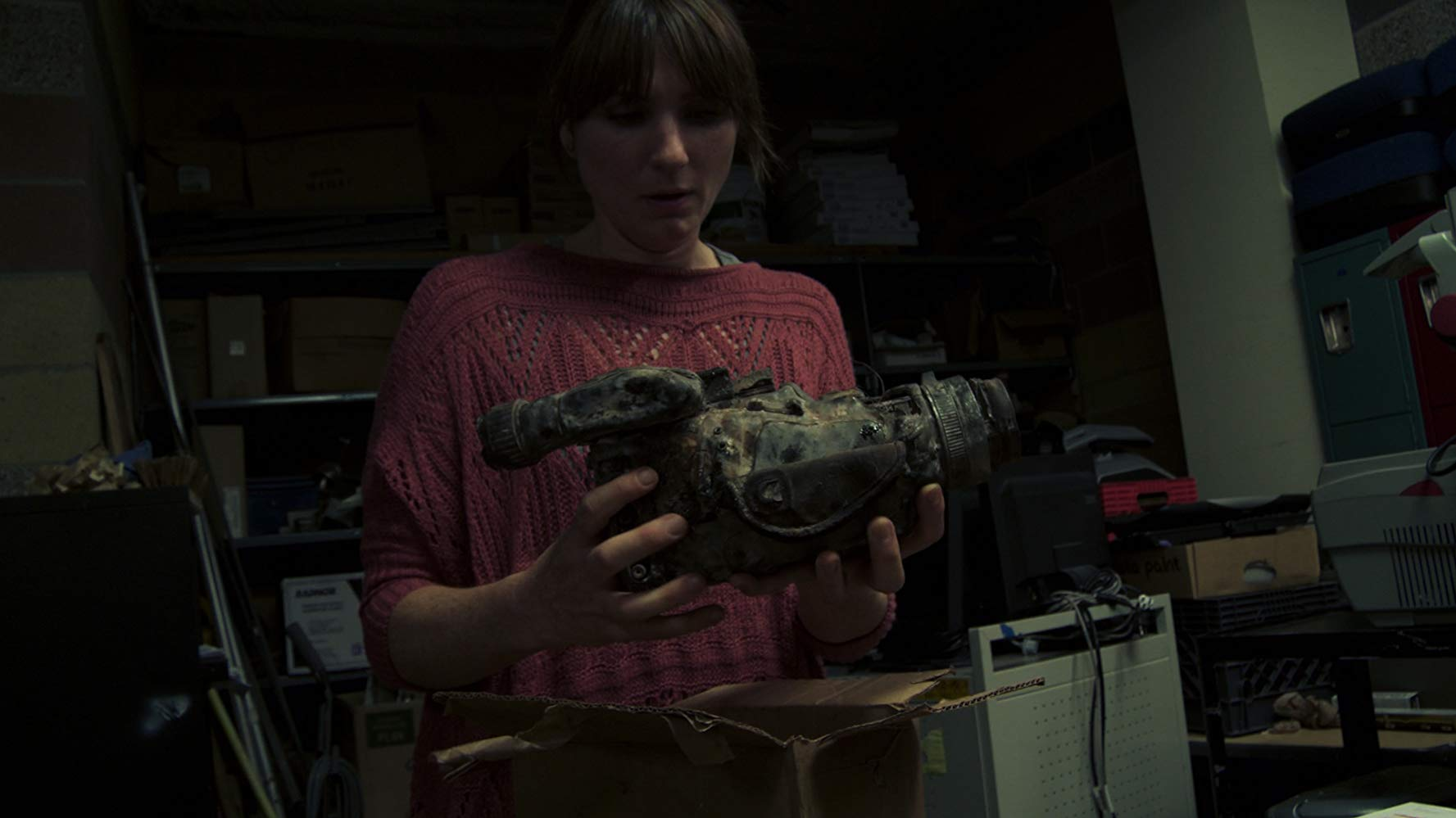Florence Hartigan discovers a videocamera in Phoenix Forgotten (2017)