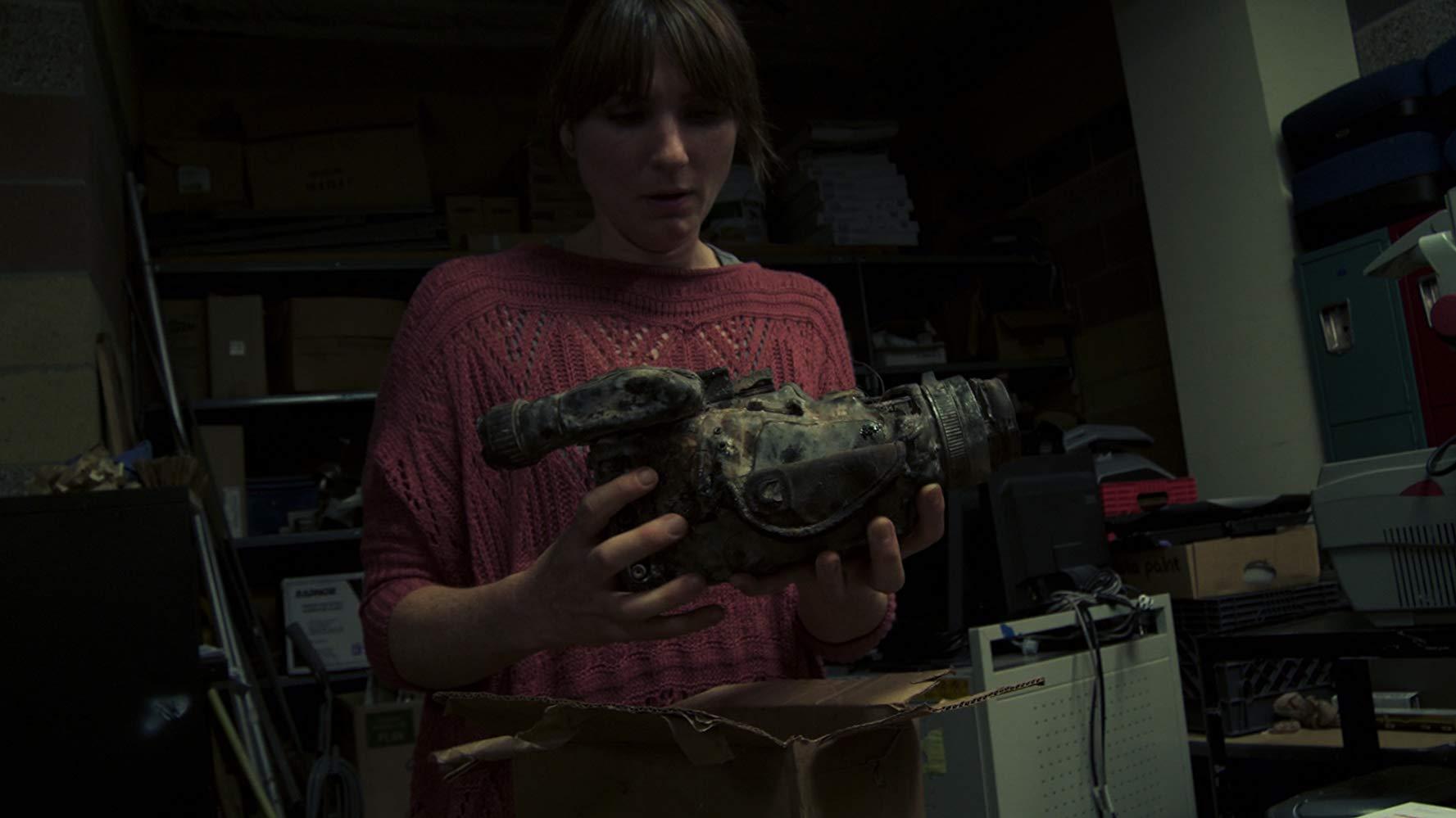 Florence Hartigan discovers a videocamera in Phoenix Forgotten (2017)