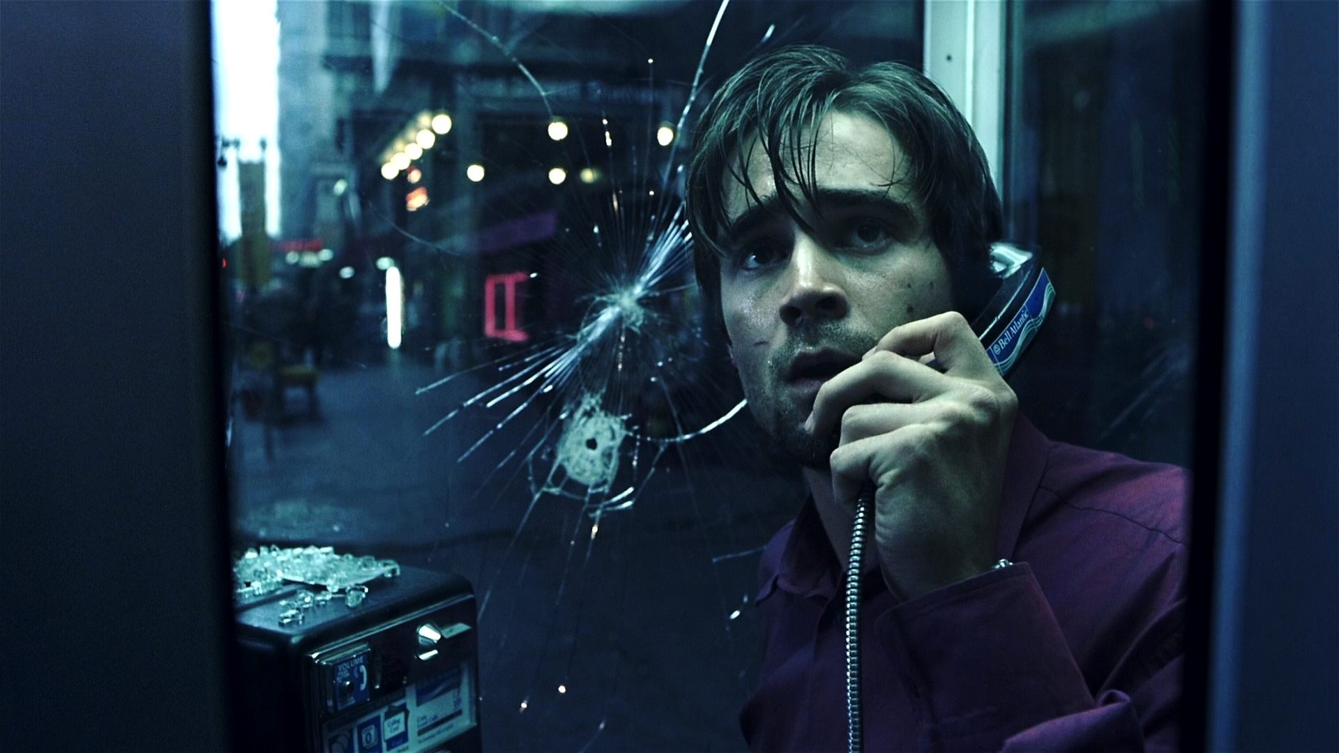 Colin Farrell trapped in a phone booth by a sniper in Phone Booth (2002)