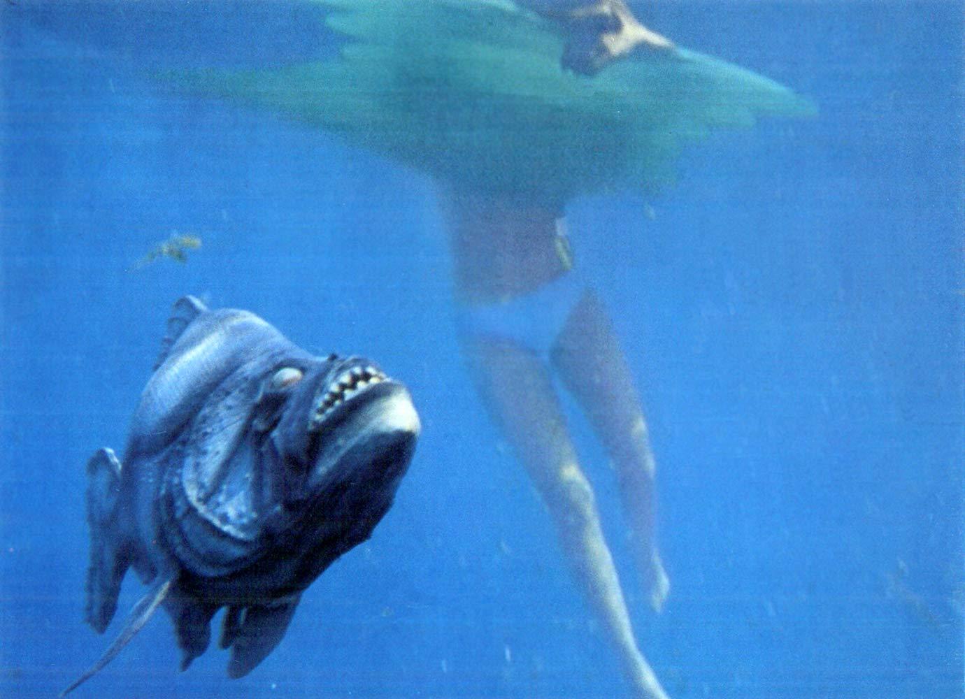 The piranha attack a bather in Piranha (1978)
