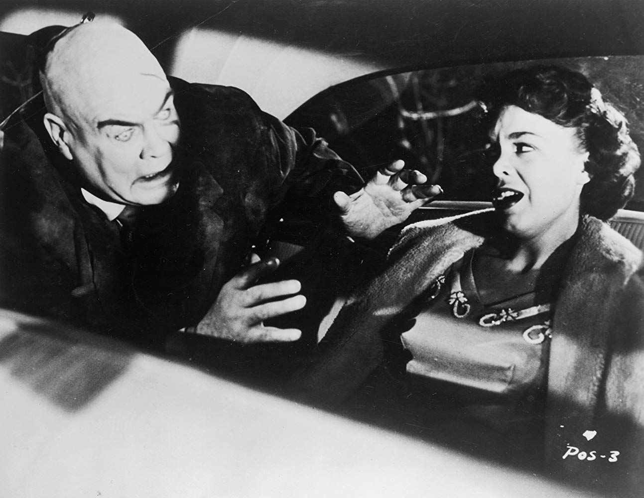 The zombified Tor Johnson advances on Mona McKinnon in Plan 9 from Outer Space (1959)