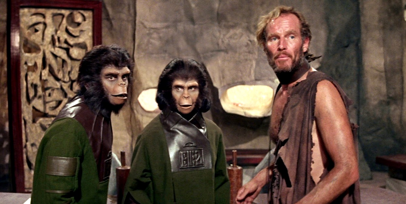 Human astronaut Colonel Taylor (Charlton Heston) and his two chimpanzee friends Cornelius (Roddy McDowall) (l) and Zira (Kim Hunter) (c) in Planet of the Apes (1968)