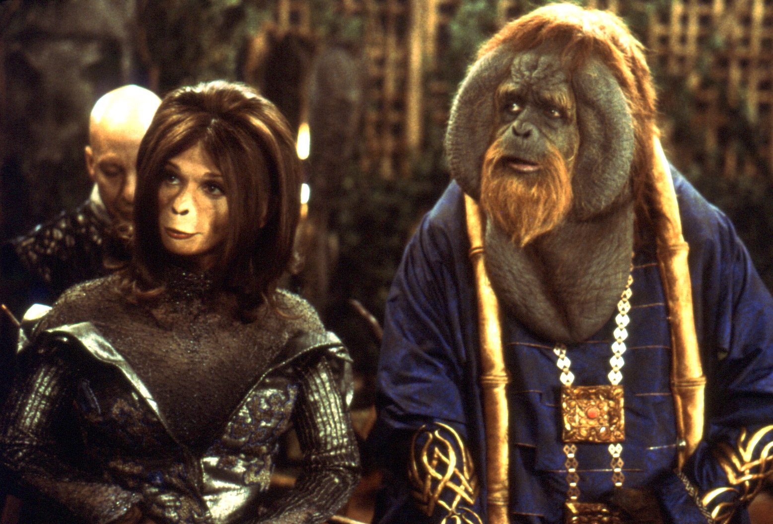 Ari (Helena Bonham Carter) and Senator Nado (Glenn Shadix) in Planet of the Apes (2001)