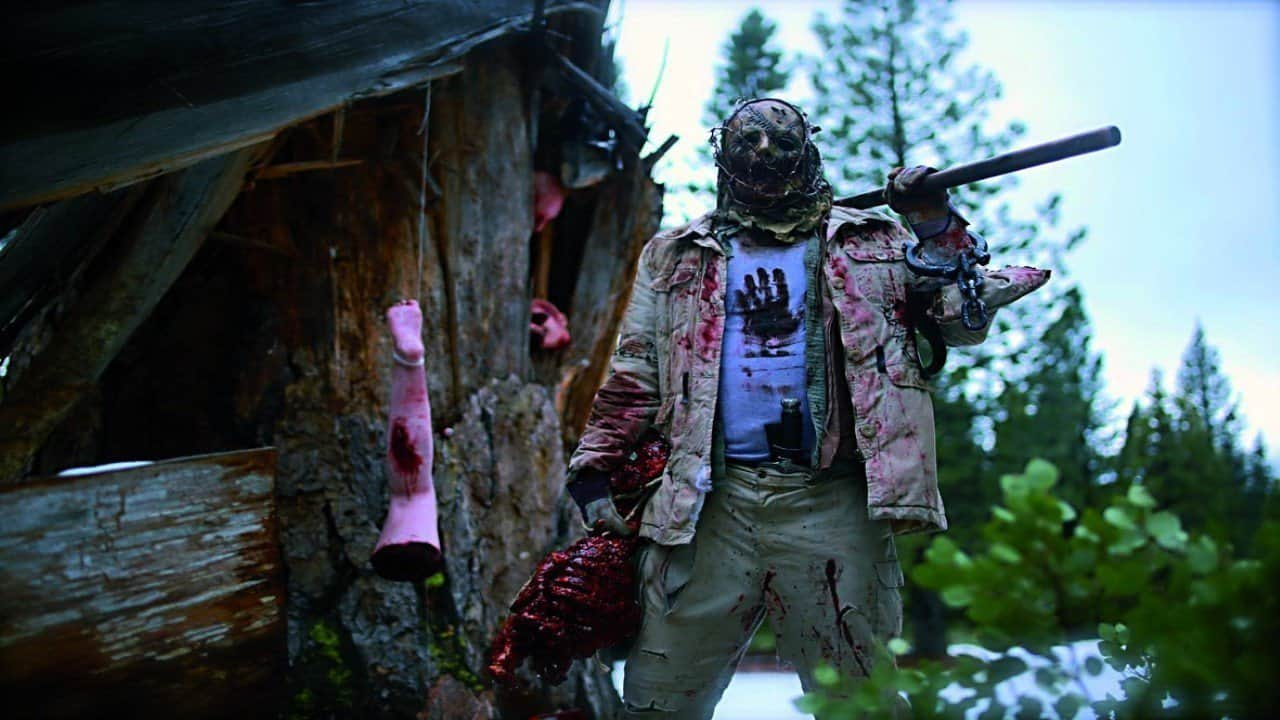 The Killer (Charlie Glackin) in Playing with Dolls (2015)