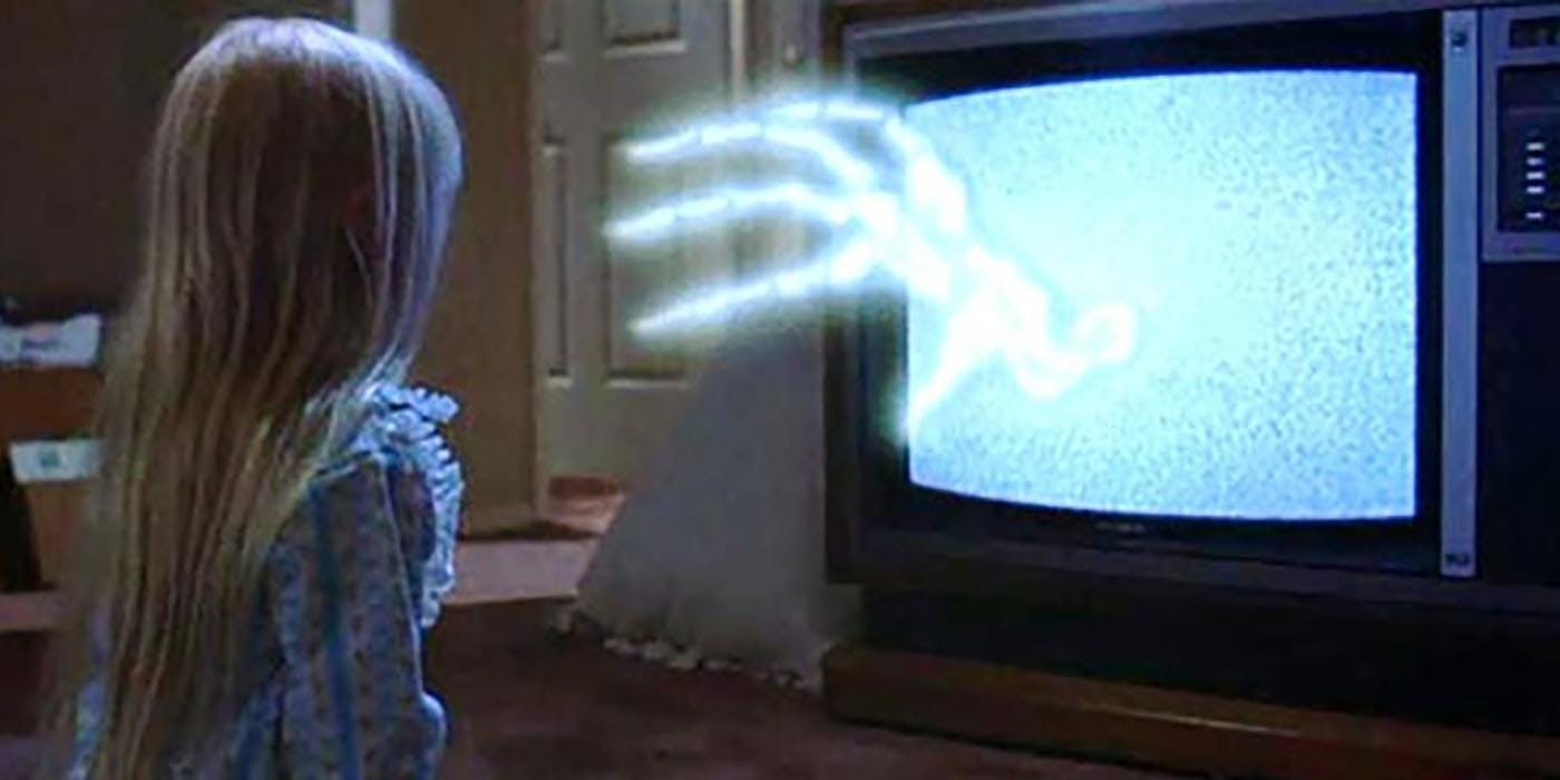 The tv reaches out to Carol Ann (Heather O'Rourke) in Poltergeist (1982)