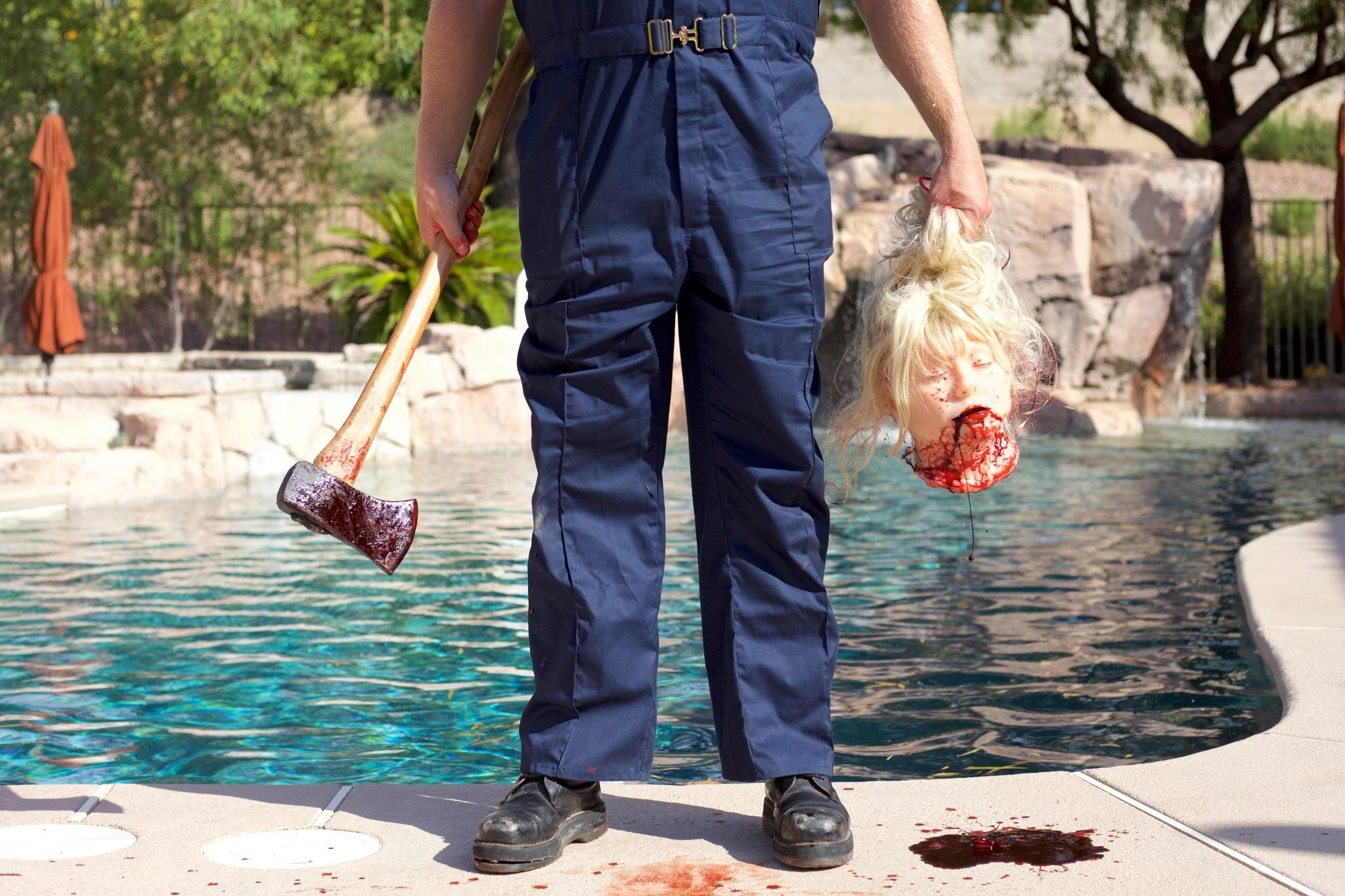 The killer with severed head in Pool Party Massacre (2017)