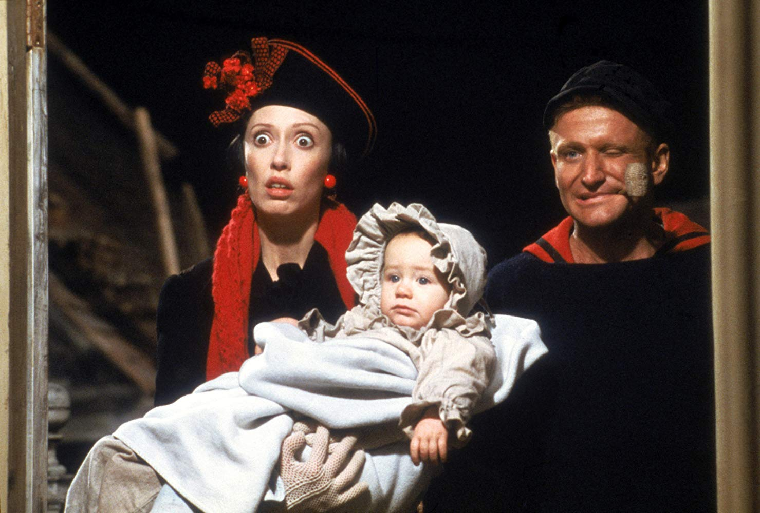 Olive Oyl (Shelley Duvall) and Popeye (Robin Williams) with baby Swee'pea (Wesley Ivan Hurt) in Popeye (1980)