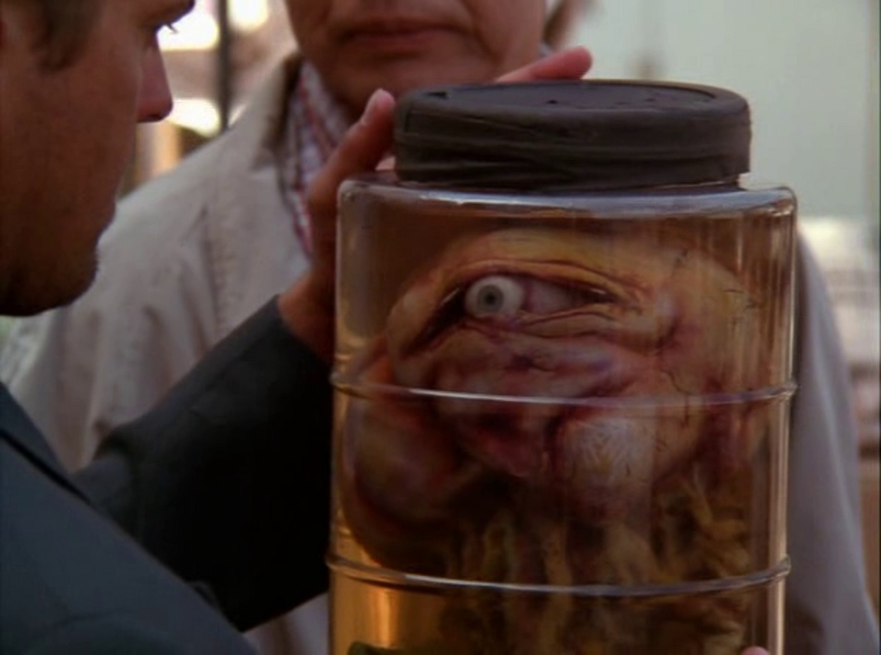 Evil mind-controlling creature in a jar in Possessed By the Night (1994)