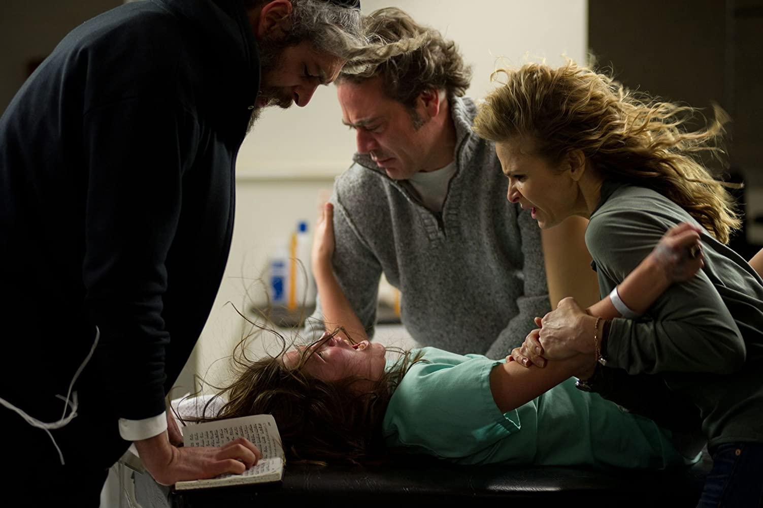 Rabbi Matisyahu, Jeffrey Dean Morgan and Kyra Sedgwick hold down Natasha Calis in The Possession (2012)