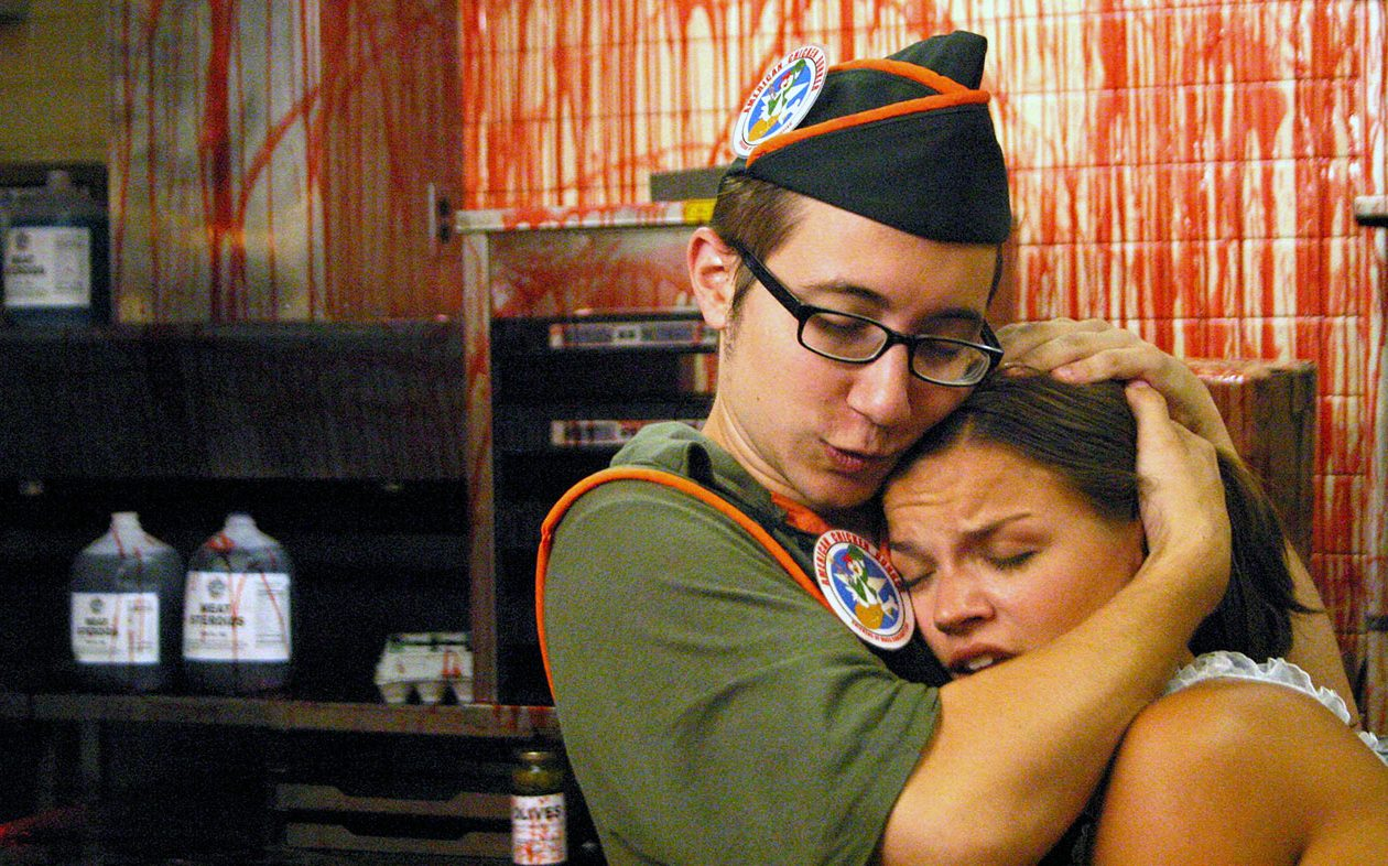 Jason Yachanin comforts Kate Graham in Poultrygeist Night of the Chicken Dead (2006)
