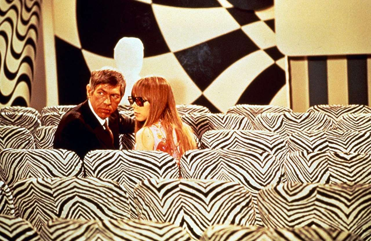 James Coburn and Joan Delaney on the run amid a host of conspiracies in The President's Analyst (1967)