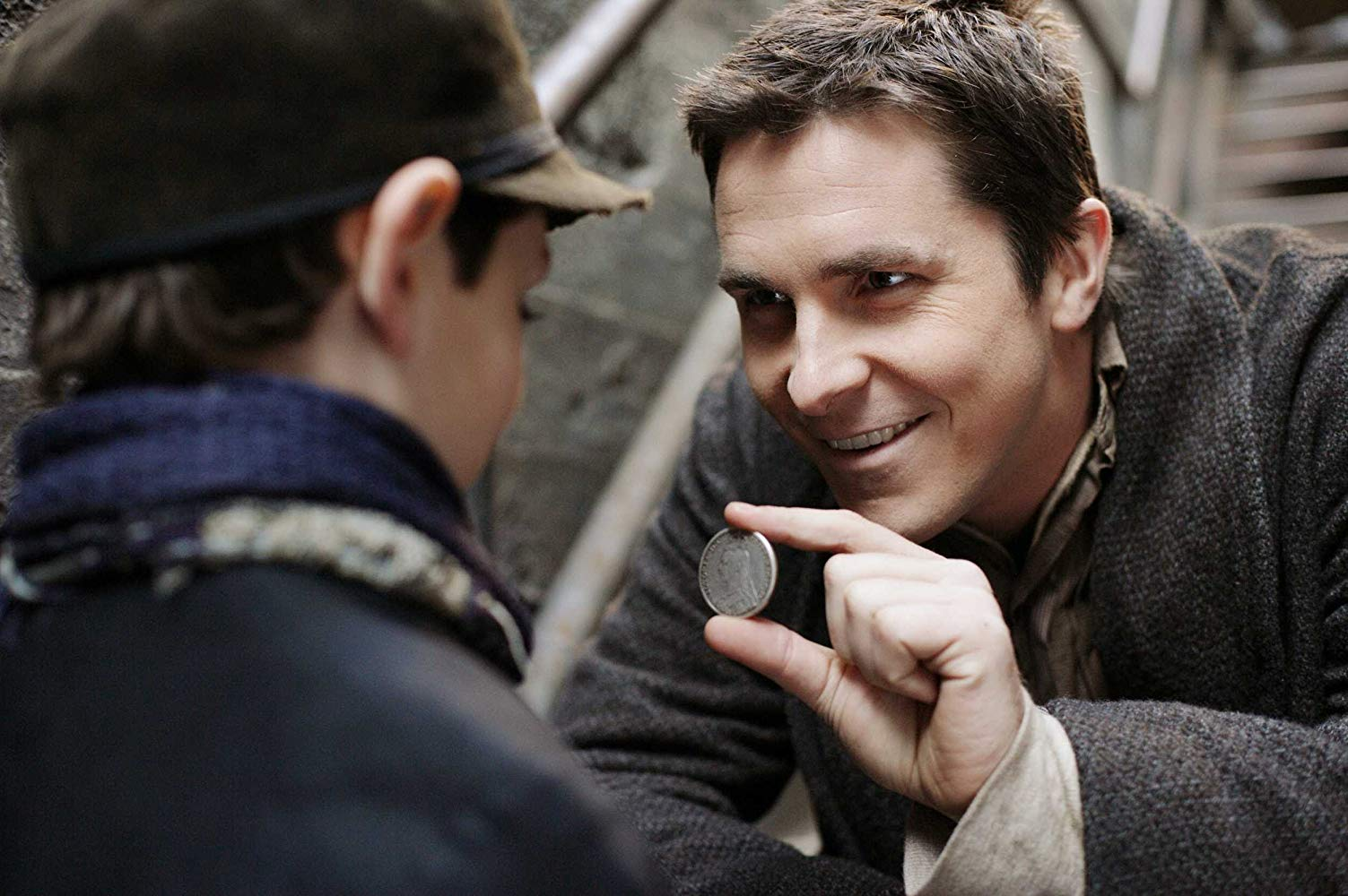 Alfred Borden (Christian Bale) performs a magic trick for a young friend in The Prestige (2006)