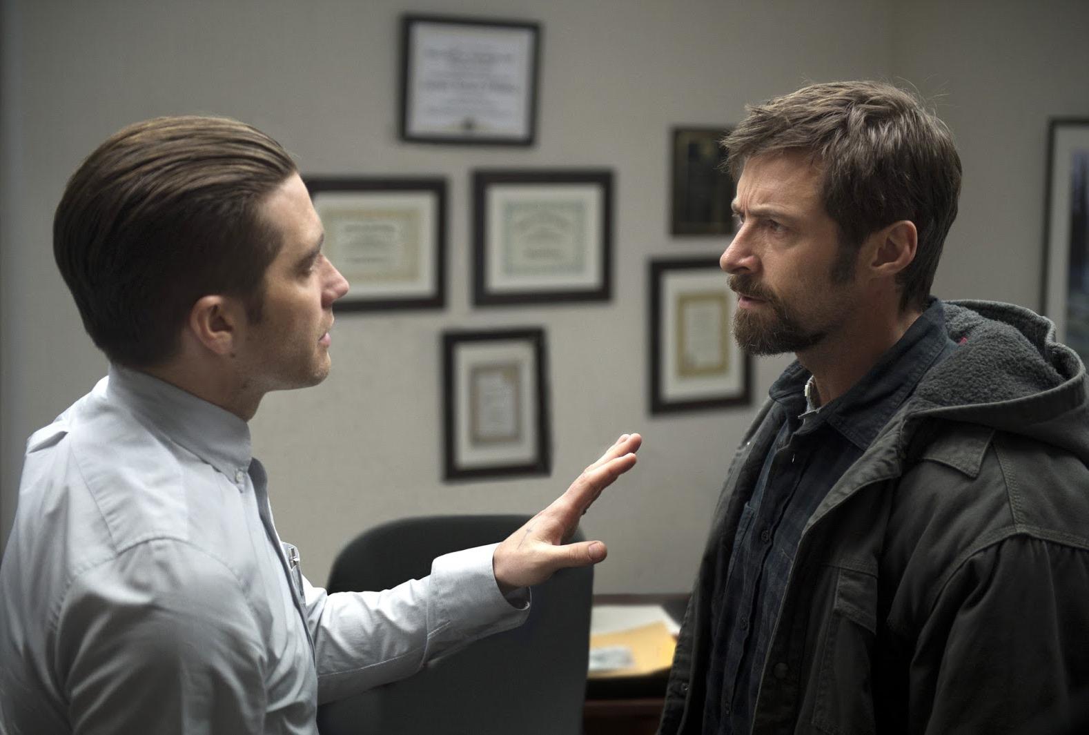 Jake Gyllenhaal and Hugh Jackman in Prisoners (2013)