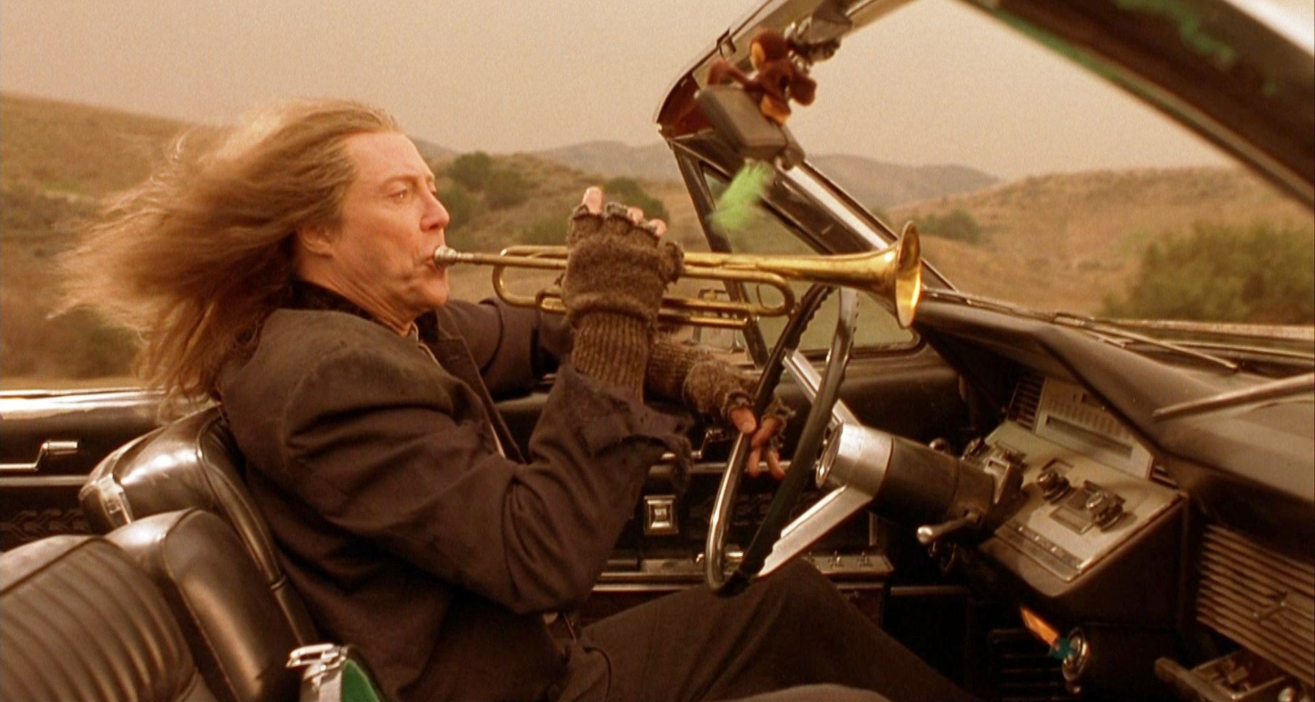 The angel Gabriel (Christopher Walken) playing the Last Trumpet while driving in The Prophecy 3: The Ascent (2000)