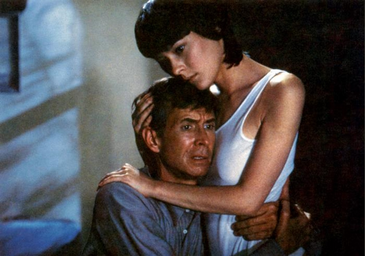 Mary Samuels (Meg Tilly) comforts Norman Bates (Anthony Perkins) in Psycho II (1983)