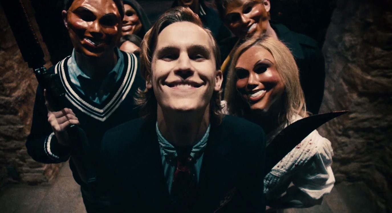 The crazies outside the door in The Purge (2013)