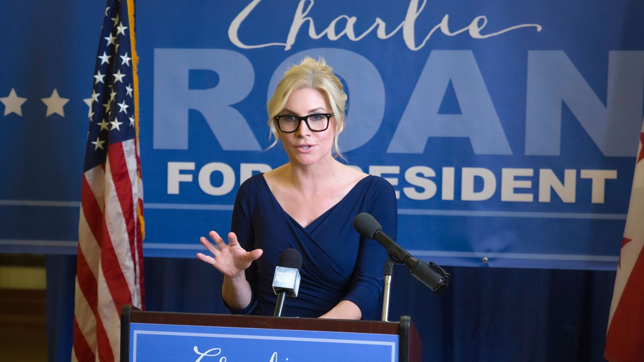 Elizabeth Mitchell as liberal presidential candidate Charlie Roan in The Purge: Election Year (2016)