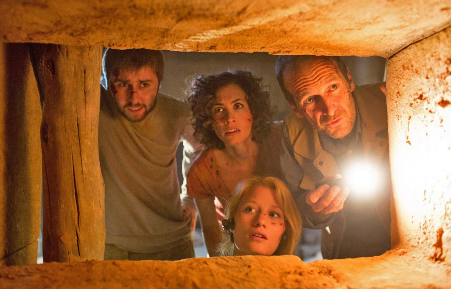 Venturing into an Ancient Egyptian tomb - (l to r) James Buckley, Christa-Marie Nicola, Ashley Hinshaw and Denis O'Hare in The Pyramid (2014)