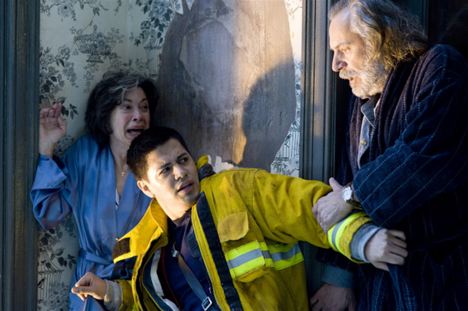 (l to r) Elaine Kagan and fireman Jay Hernandez recoil from Rade Serbedzija in Quarantine (2008)