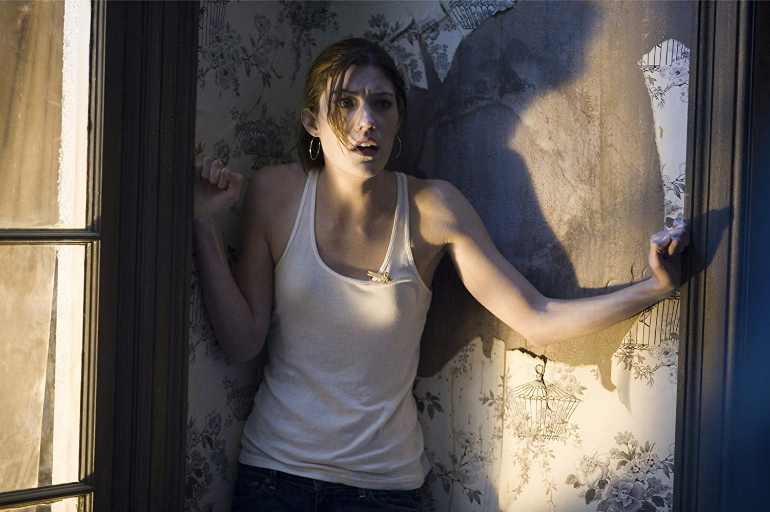 News reporter Jennifer Carpenter trapped in a zombie-infected apartment building in Quarantine (2008)