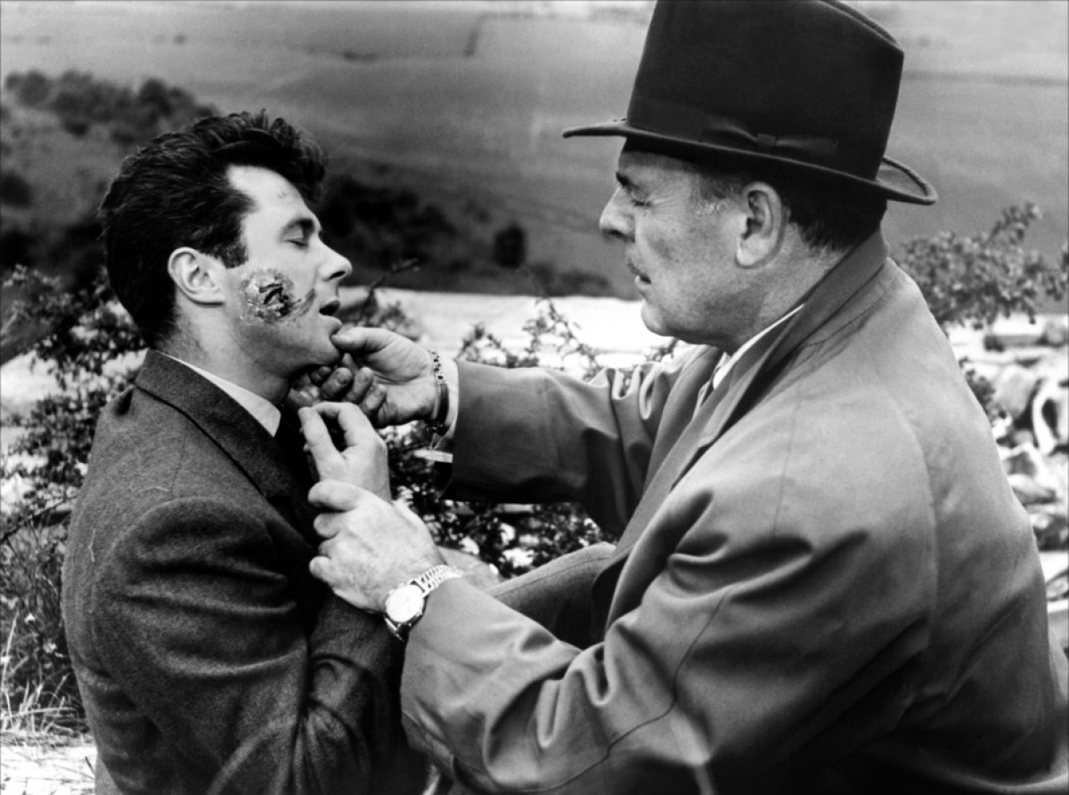 Professor Quatermass (Brian Donlevy) discovers his assistant Marsh (Bryan Forbes) is infected after touching a meteorite in Quatermass 2 (1957)