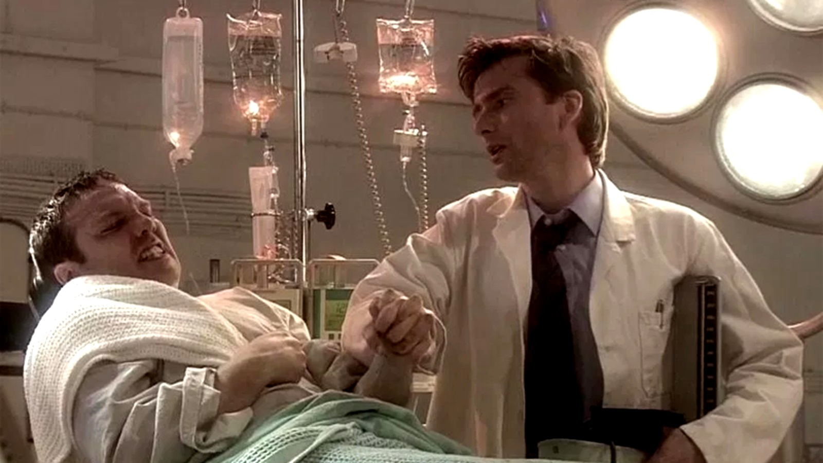 Infected astronaut Victor Carroon (Andrew Tiernan) and doctor David Tennant in The Quatermass Experiment (2005)
