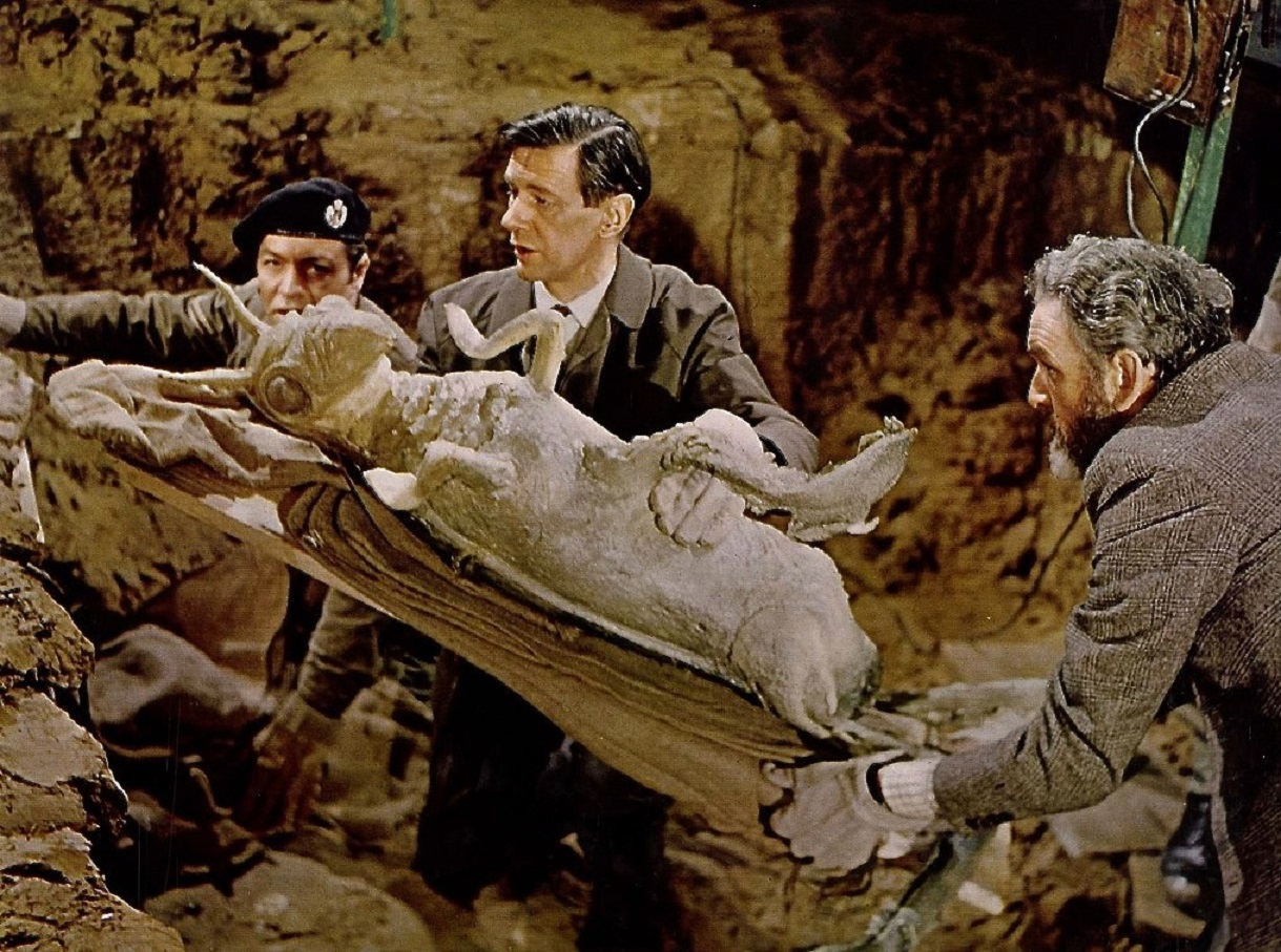 Professor Quatermass (Andrew Keir) and Ronay (James Donald) uncover the body of the Martian from the subway in Quatermass and the Pit (1967)