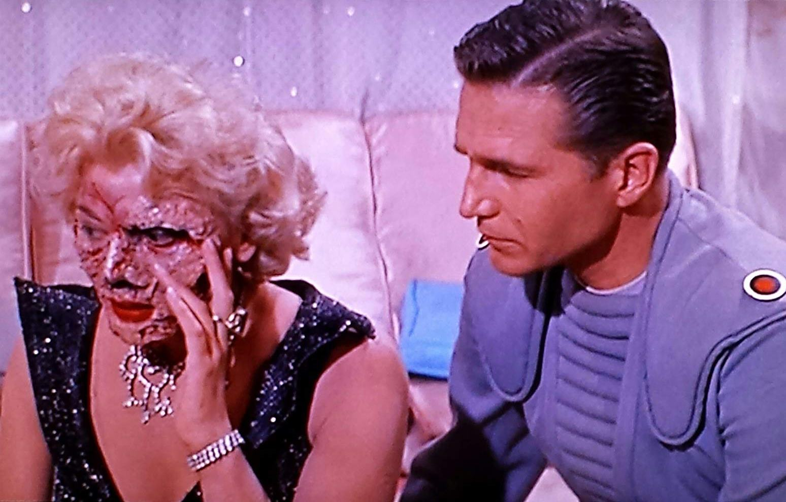 Captain Eric Fleming and Laurie Mitchell as the disfigured Queen Yllana in Queen of Outer Space (1958)