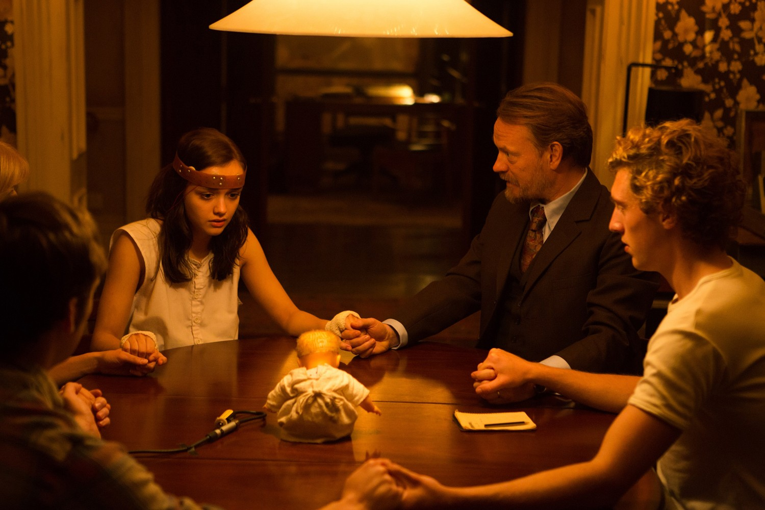 The seance - (l to r) Olivia Cooke, Jared Harris and Rory Fleck-Byrne in The Quiet Ones (2014)