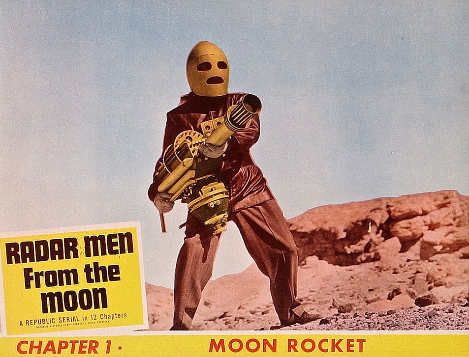 Lobby card featuring Commando Cody (George Wallace) in Radar Men from the Moon (1952)